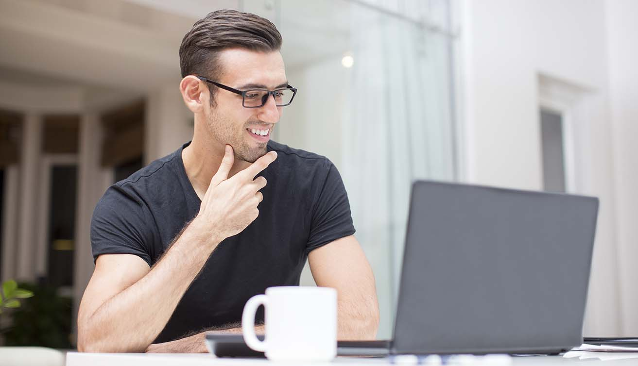 man with coffee and laptop